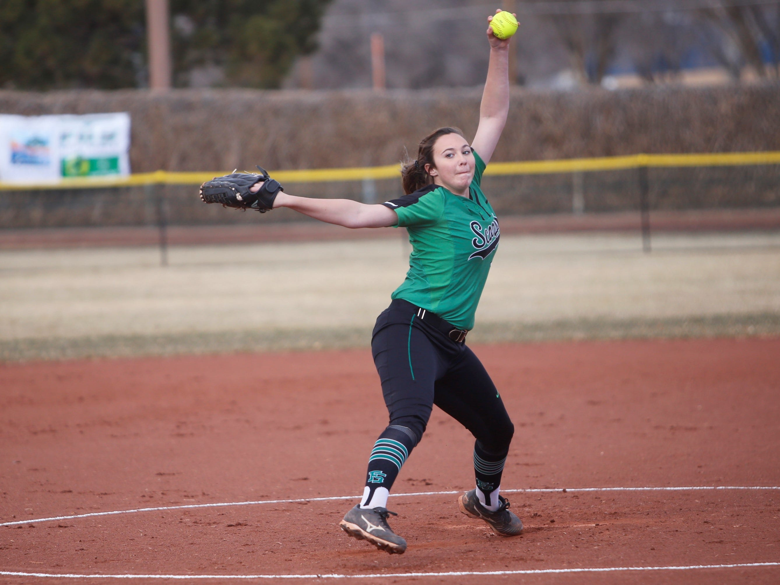 Farmington's Nicole Brimhall throws a pitch against Kirtland Central during Tuesday's game at Ricketts Softball Complex in Farmington.
