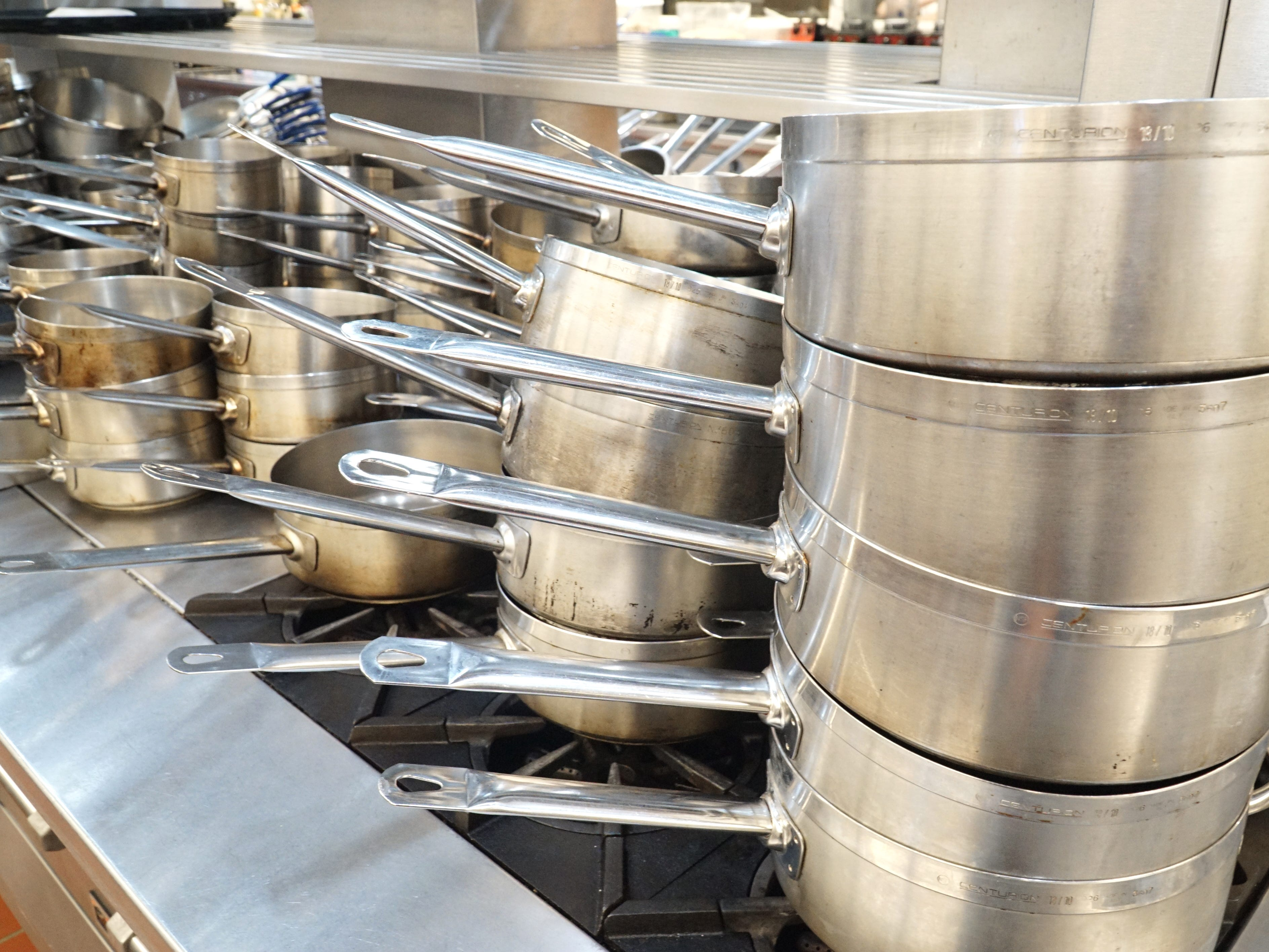 A stack of clean pots and pans await ingredients in the Vista Tech center's kitchen.