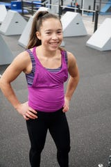 Sophie Shaft, 14, prepares to try the ninja course at the Edge Training Center in Plymouth on March 5. Shaft recently competed on the American Ninja Warrior Junior on Universal Kids network.
