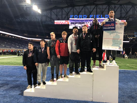 Farmington's Donovan King won the Division 2 individual state wrestling championship in the 285-pound weight class.