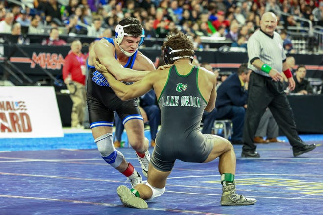 Catholic Central's Cameron Amine won his third state title.
