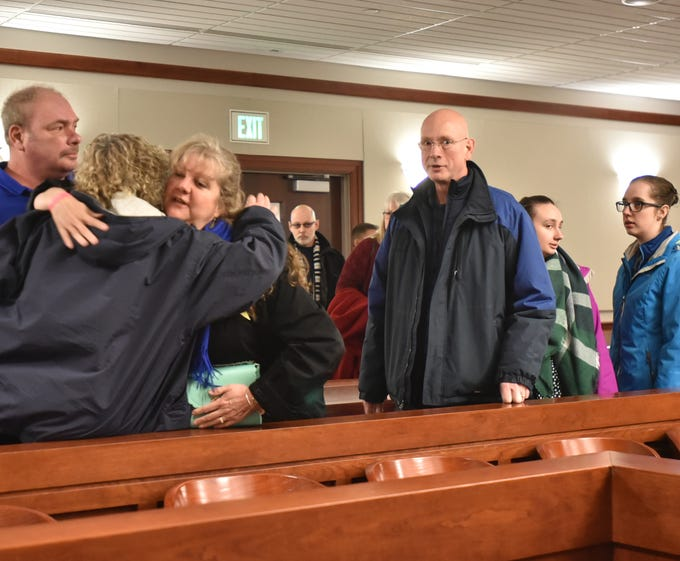 Ann Stislicki gets a hug from a supporter inside the 47th District Court in Farmington before the arraingment of Floyd Galloway in the First Degree murder of her daughter Danielle. Richard Stislicki, Danielle's father, is at right.