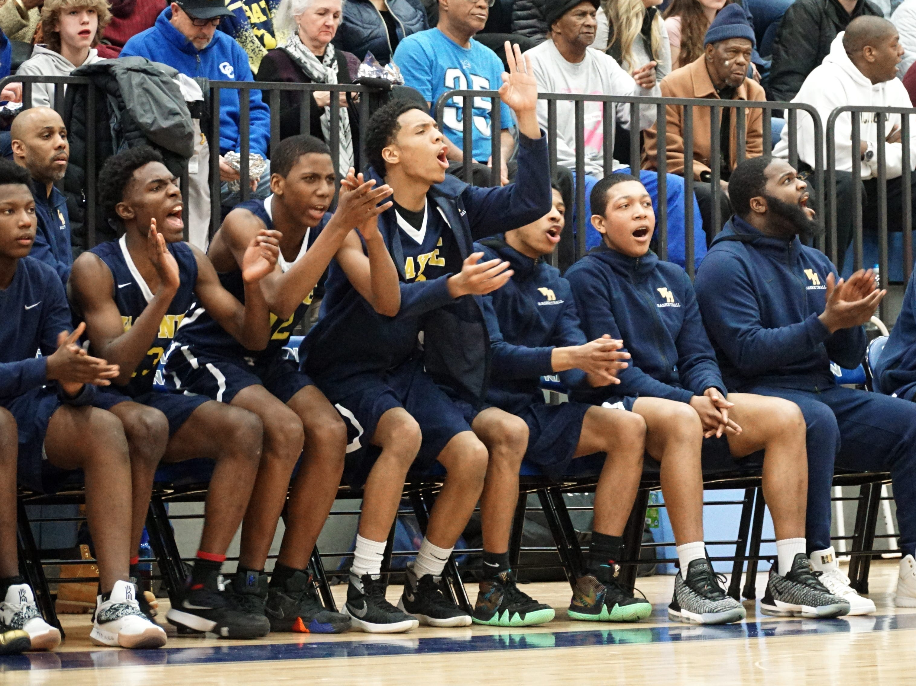 The Wayne Memorial bench has something to cheer about after a teammate hits a three-pointer.