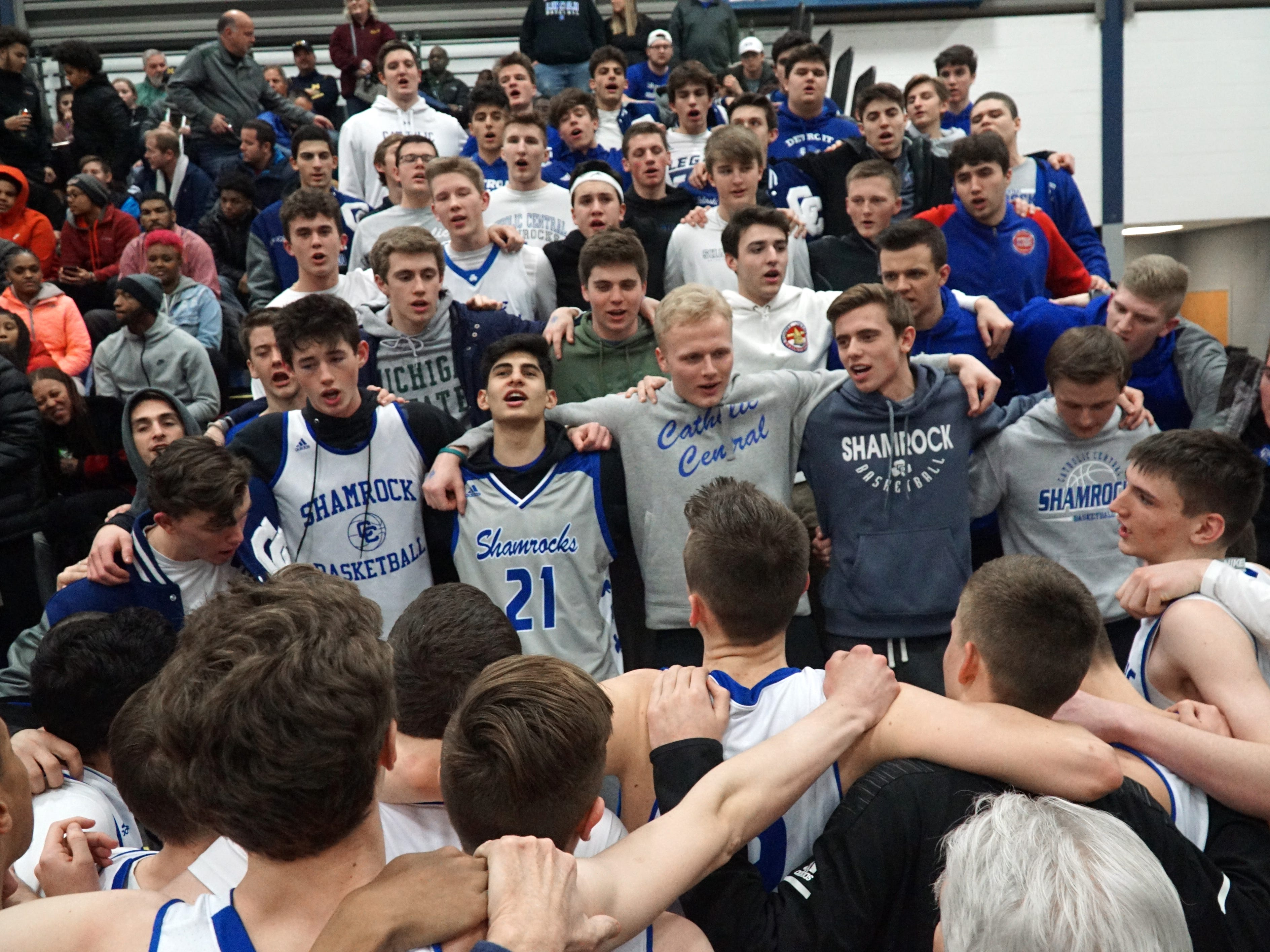The CC basketball team sings Mary Alma Mater with their fans in the stands after their March 5 victory.