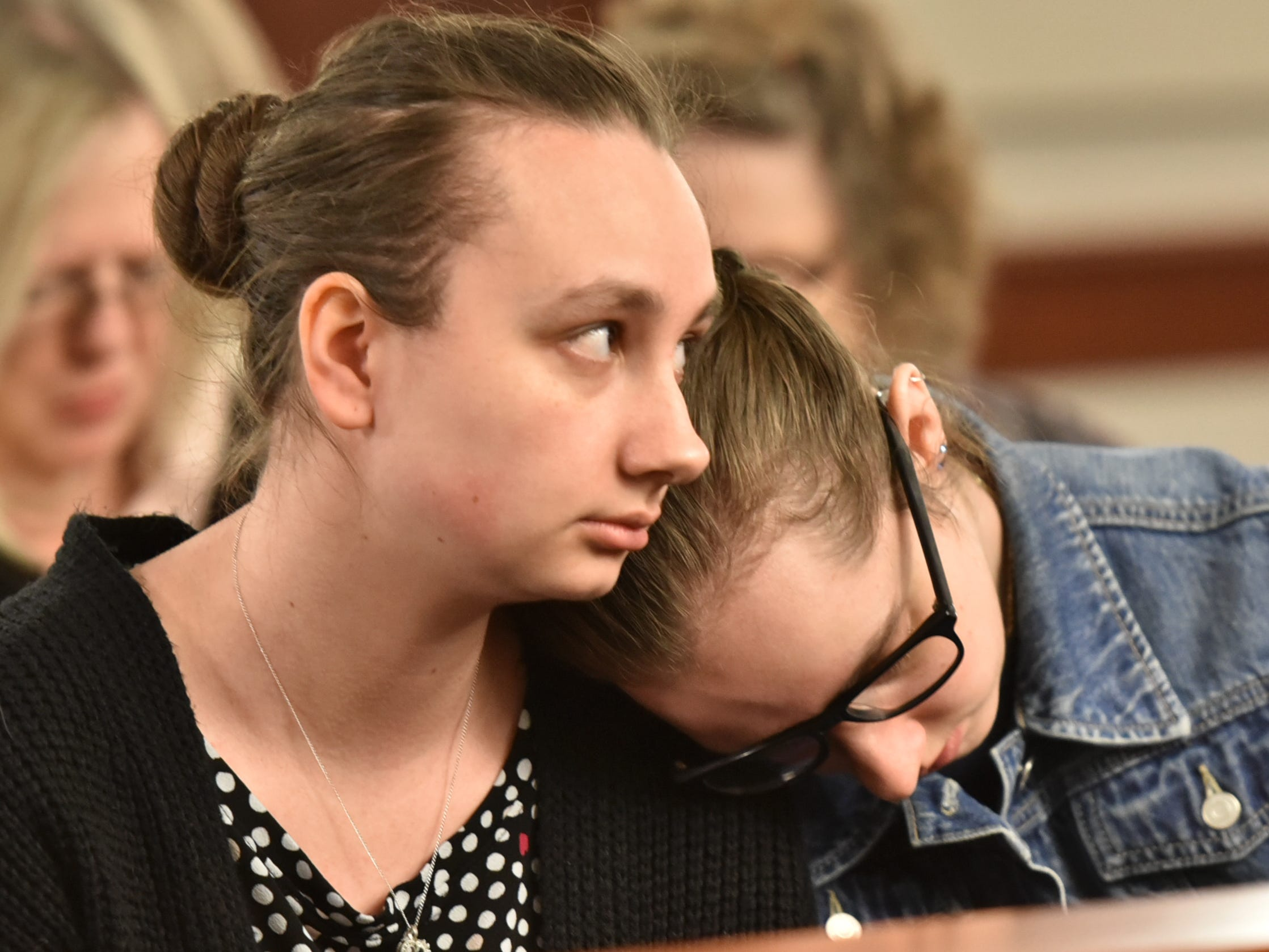 Danielle Stislicki's sisters Jillian and Holly share a quiet moment together in the 47th District Court in Farmington Hills on March 6.