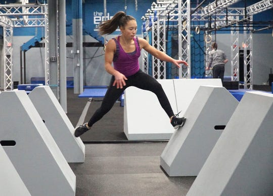 Sophie Shaft jumps from angled block to angled block in an obstacle course at the Edge Training Center in Plymouth.