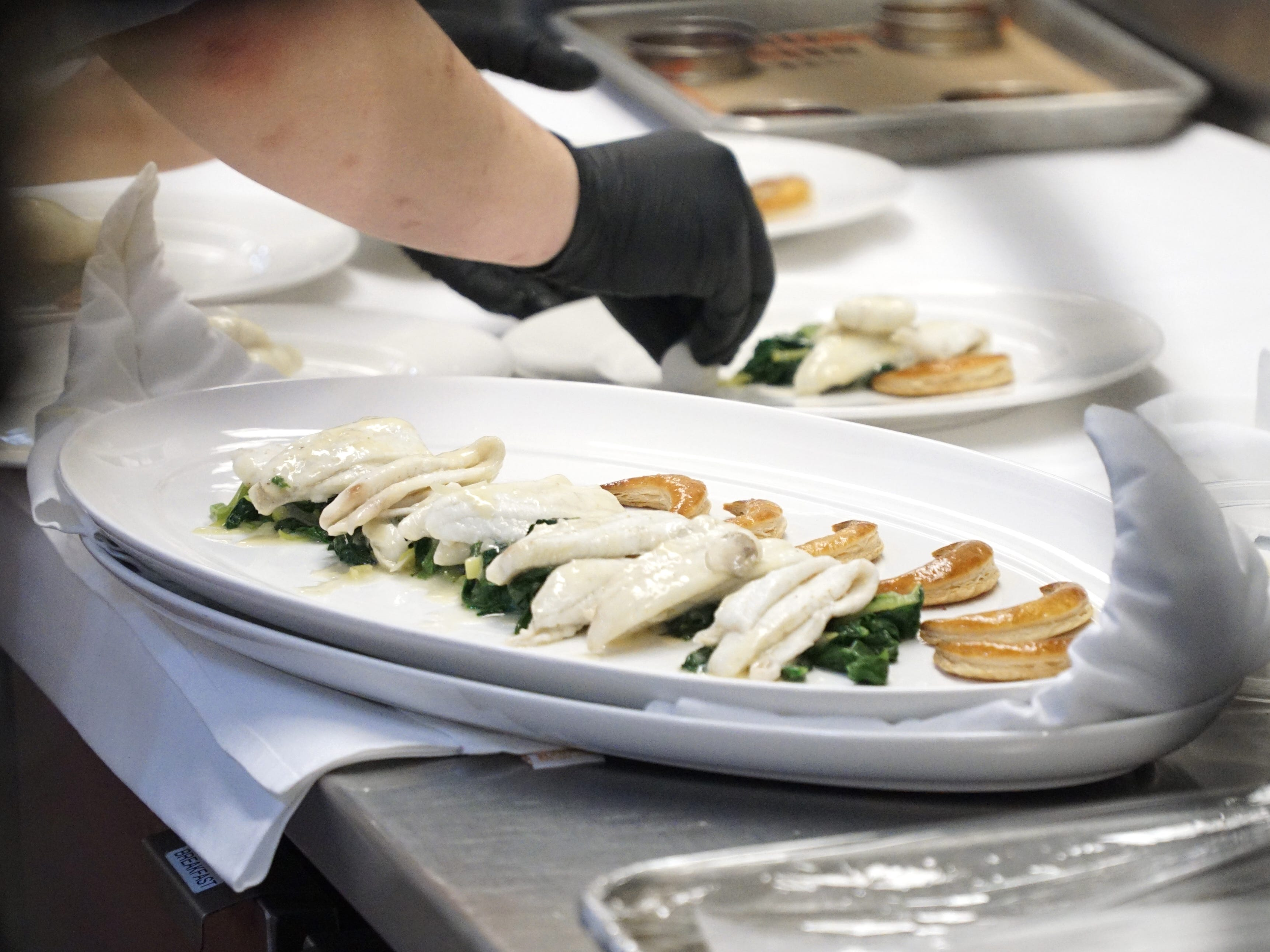 Bucci's filet of sole is plated and readied to be sampled by the other chefs.