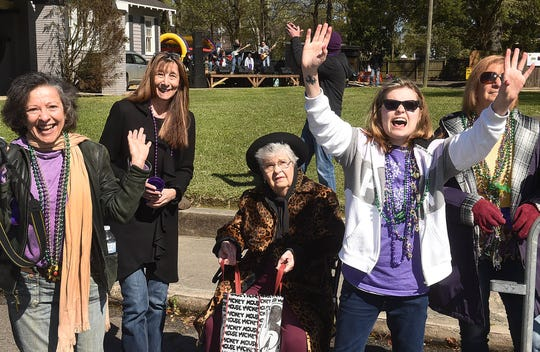 Kadie Miller screams for more beads at the Opelousas Imperial Mardi Gras Parade.