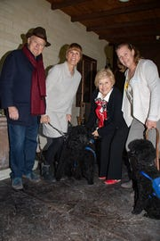 (left to right) Event host Steve Maloney, Guide Dogs of the Desert puppy raiser Judy Northrup with guide dog Shadoe, event host Yvonne Maloney, Angel Coleman with guide dog Clark, Guide Dogs of the Desert breeding/medical manager with guide dog Sarah.
