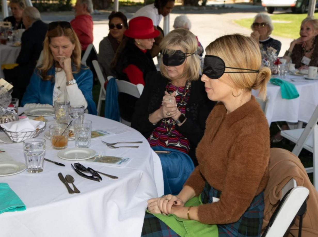 (left to right) Guests were asked to close their eyes or wear a blindfold to experience what being blind feels like.
