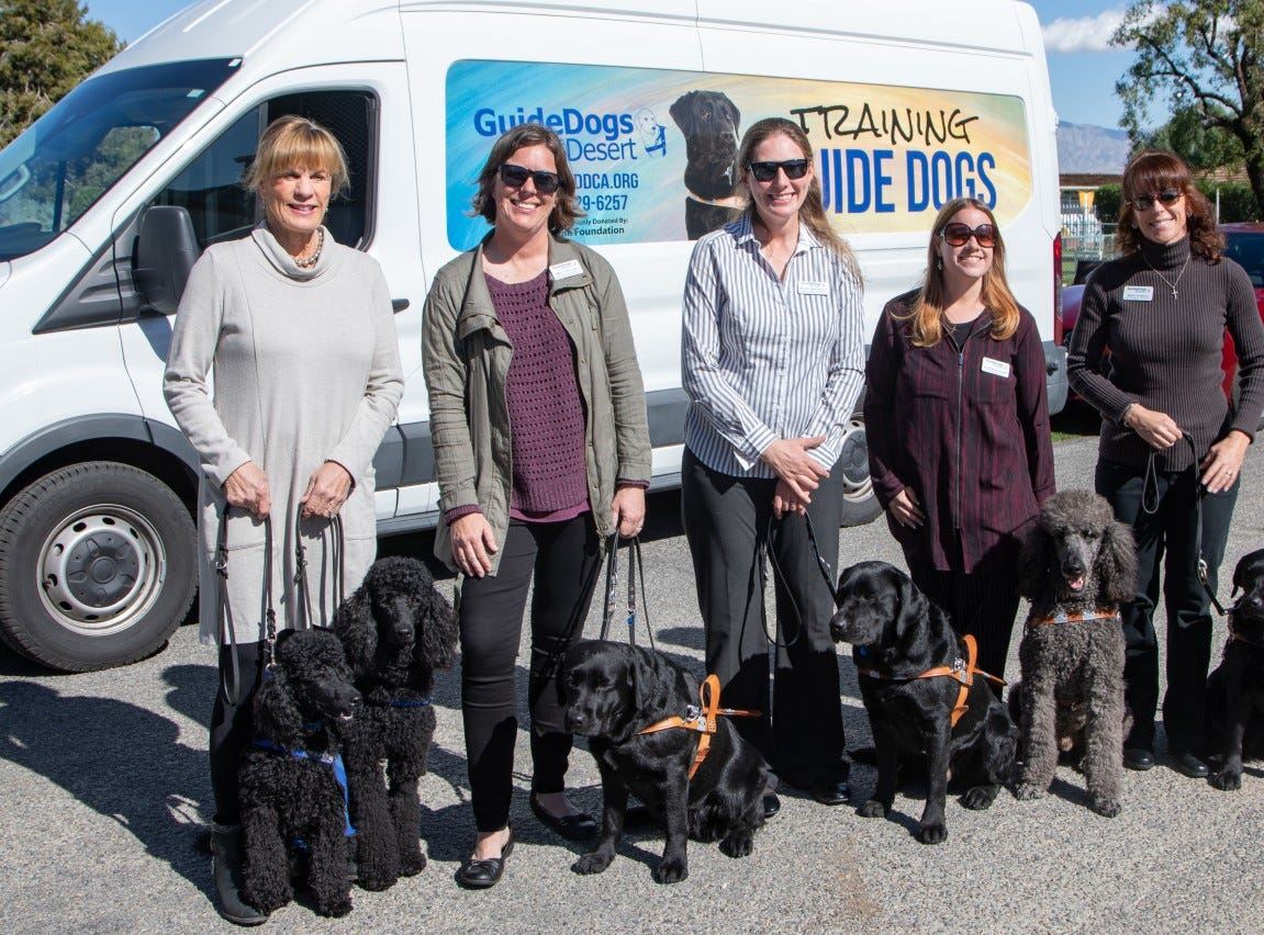 (left to right) Puppy raiser Judy Northrup, Guide Dogs' trainer Emily Goodland, Guide Dogs' senior trainer Michal Anna Padilla, Guide Dogs' apprentice trainer Kelsi McCausland, and Guide Dogs' trainer Mindy Romero.