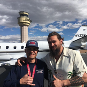 """Aquaman"" actor Jason Momoa and Palm Springs Fire Department engineer Andy Meza pose at Palm Springs International Airport. The actor was aboard an aircraft that reported an engine fire; it turned out to be a ""false alarm,"" according to the Instagram post."