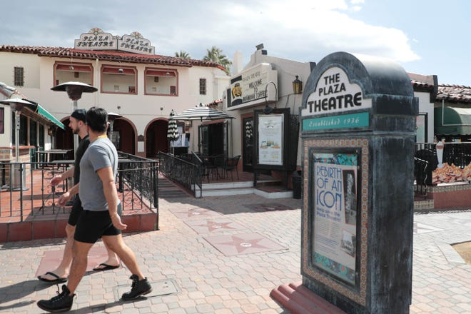 Signs for the Plaza Theatre sit outside of the building on March 6, 2019 in Palm Springs, Calif.