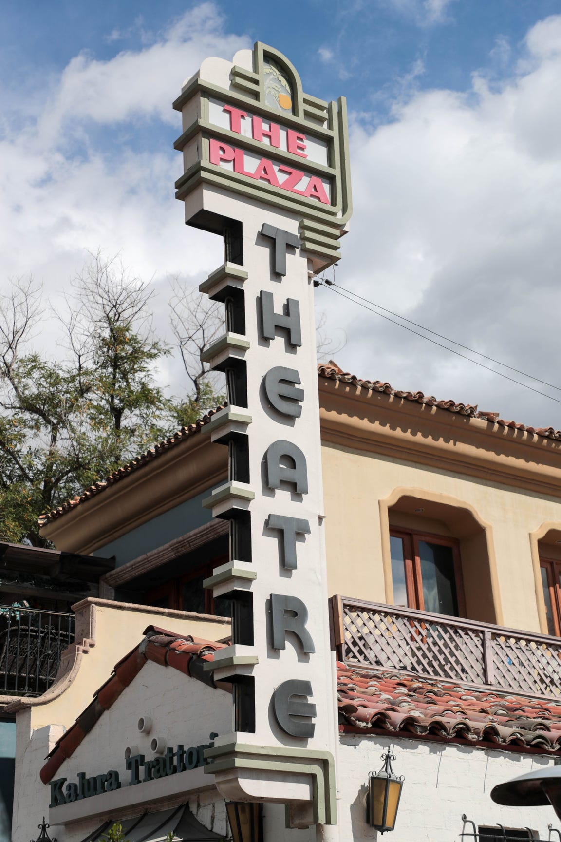A sign for the Plaza Theatre sits outside of the building on March 6, 2019 in Palm Springs, Calif.