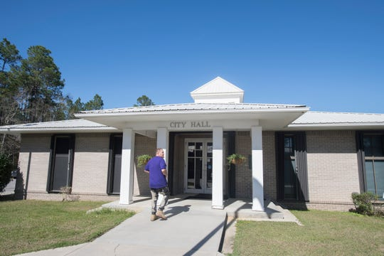 Century's City Hall is pictured Wednesday. The town's mayor, Henry Hawkins, says he supports most of a grand jury's recommendations on correcting issues in the town, but he is opposed to getting rid of its utilities.