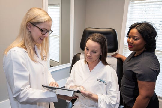 Dr. Ashley Chandler (left) began focusing on microsurgery to provide women in Pensacola with innovative reconstructive breast procedures.