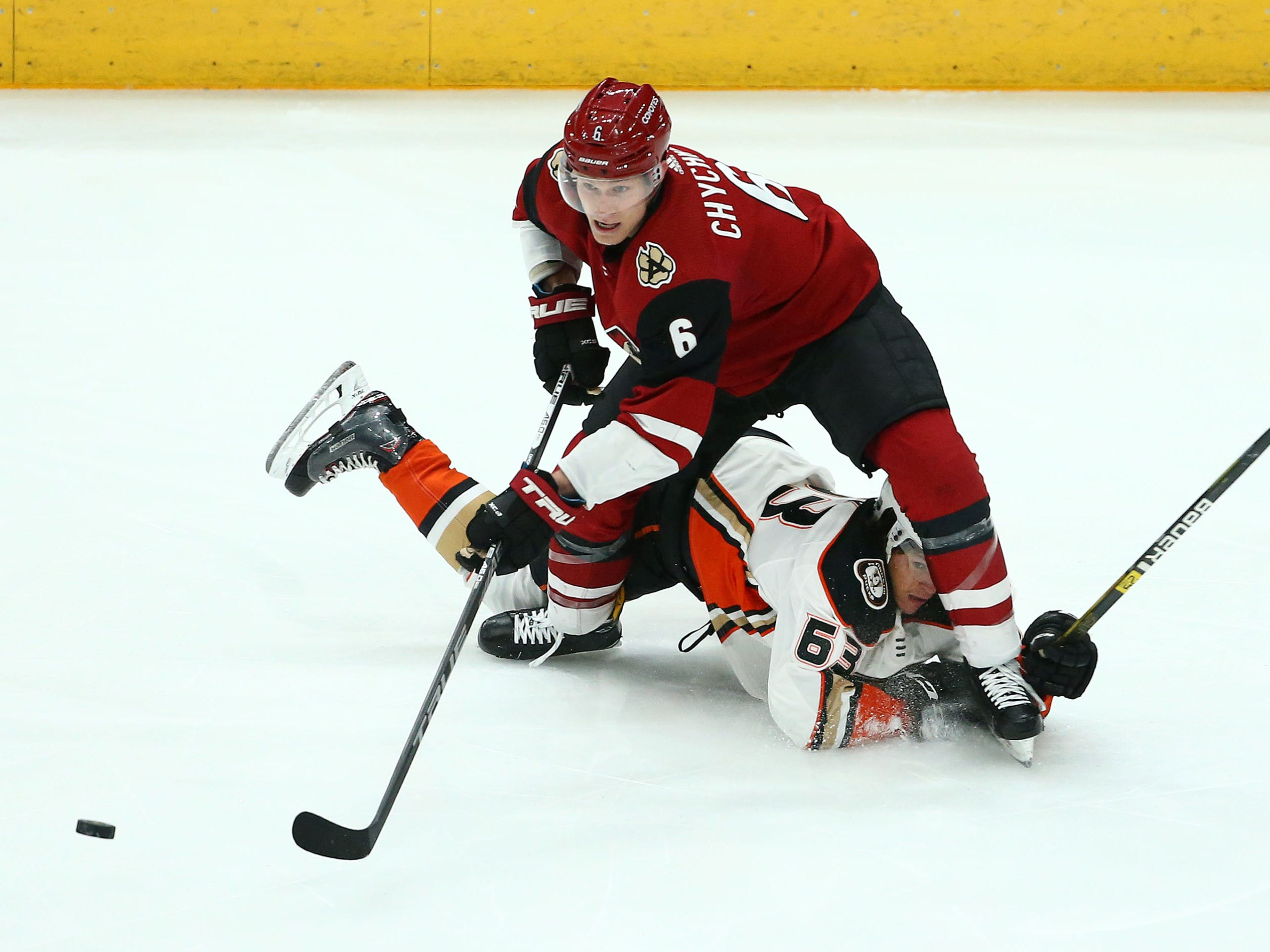 Arizona Coyotes defenseman Jakob Chychrun (6) collides with Anaheim Ducks left wing Kevin Roy (63) in the first period on Mar. 5, 2019, at Gila River Arena in Glendale, Ariz.