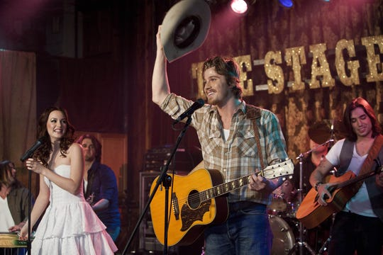"Leighton Meester and Garrett Hedlund play musicians in the 2010 film ""Country Strong."""