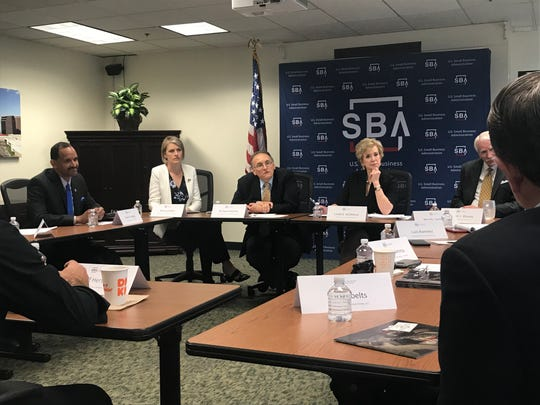 Linda McMahon, head of the Small Business Administration, listens to local business representatives in Phoenix.