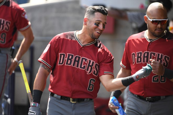 David Peralta #6 of the Arizona Diamondbacks talks with teammates in the dugout prior to a spring training game against the Milwaukee Brewers at Maryvale Baseball Park on March 06, 2019 in Phoenix, Arizona.