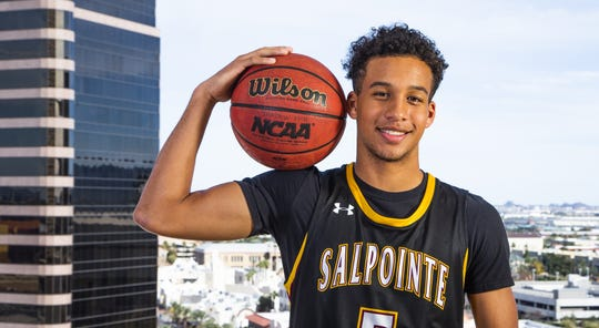 Evan Nelson of Salpointe Catholic poses for All-Arizona boys basketball team member photo at the Republic Media Building in Phoenix, Monday, March 4, 2019.