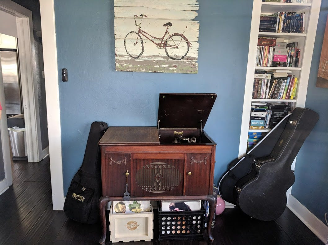 The front room of the home in the Coronado Historic is filled with vintage pieces, including a desk, a filing cabinet and a working Brunswick record player.