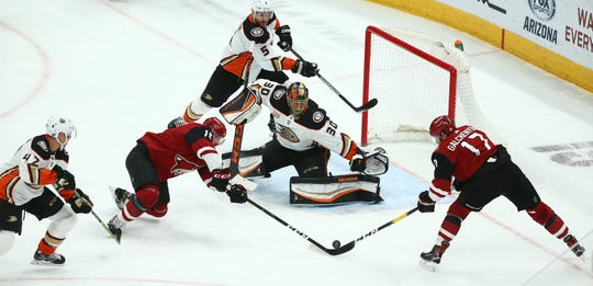 Coyotes left wing Alex Galchenyuk misses the net on a shot during a game March 5 against the Ducks at Gila River Arena.