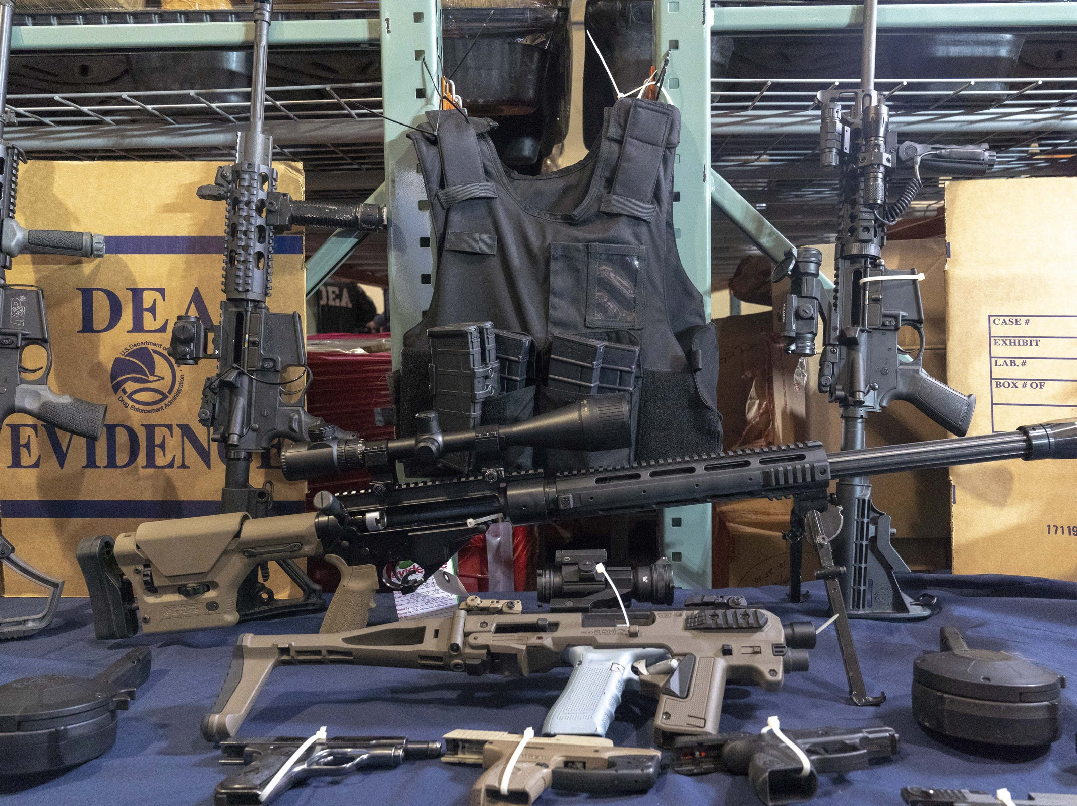 DEA agents show stored weapons at a facility in the Phoenix area on March 5, 2019.