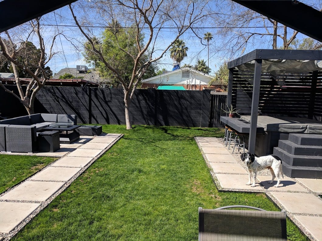 Owen and Miller transformed a backyard that just had grass when they moved in, to one that includes a hot tub and bar, a fire pit, and a side dining area.