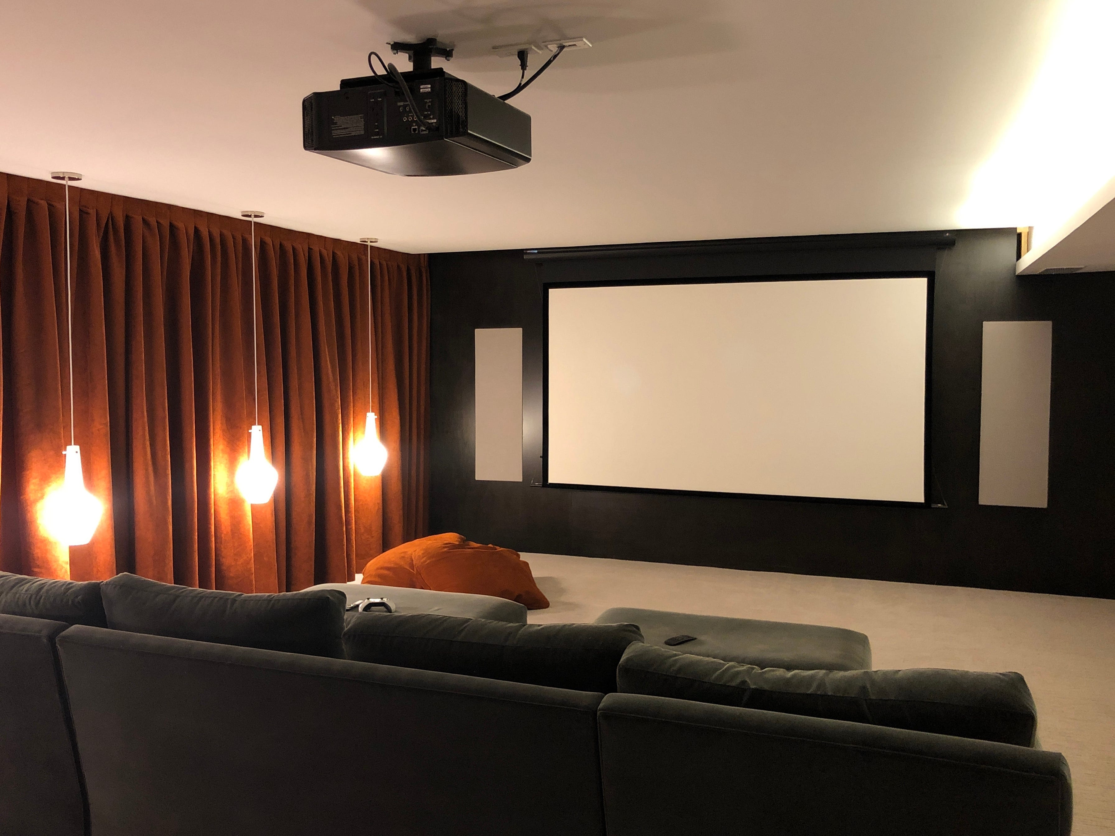 Vierra turned the basement into a movie theater complete with blackout curtains, top-of-the-line sound and video equipment, soundproofing and plushy seating.