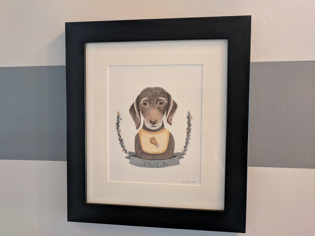 Tuck, a stray dog they adopted after finding him at Tuck Shop, as illustrated by their artist friend Amy Lamp of Oxford Dogma.