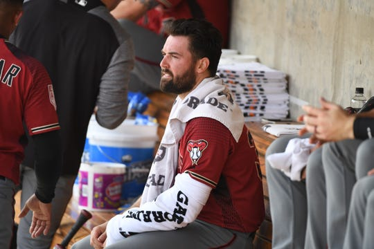 Robbie Ray #38 of the Arizona Diamondbacks sits in the dugout while preparing to pitch against the Milwaukee Brewers during a spring training game at Maryvale Baseball Park on March 06, 2019 in Phoenix, Arizona.