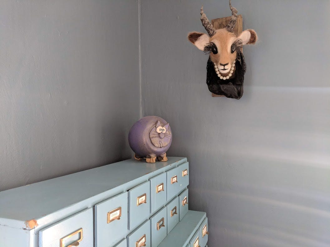 Lindsay Owen and Libbie Miller put their stamp on the home by filling it with vintage pieces and quirky ones, like the faux taxidermy that hangs in the front room.