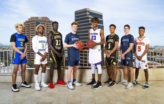 (left to right) Jaelen House and Jovan Blacksher of Shadow Mountain, Majok Deng of Salpointe Catholic, Nico Mannion of Pinnacle, DaRon Holmes of Millennium, Evan Nelson of Salpointe Catholic, Trent Brown of Pinnacle and B.J. Burries of Globe  pose for azcentral sports All-Arizona boys basketball team photo at the Republic Media Building in Phoenix, Monday, March 4, 2019.