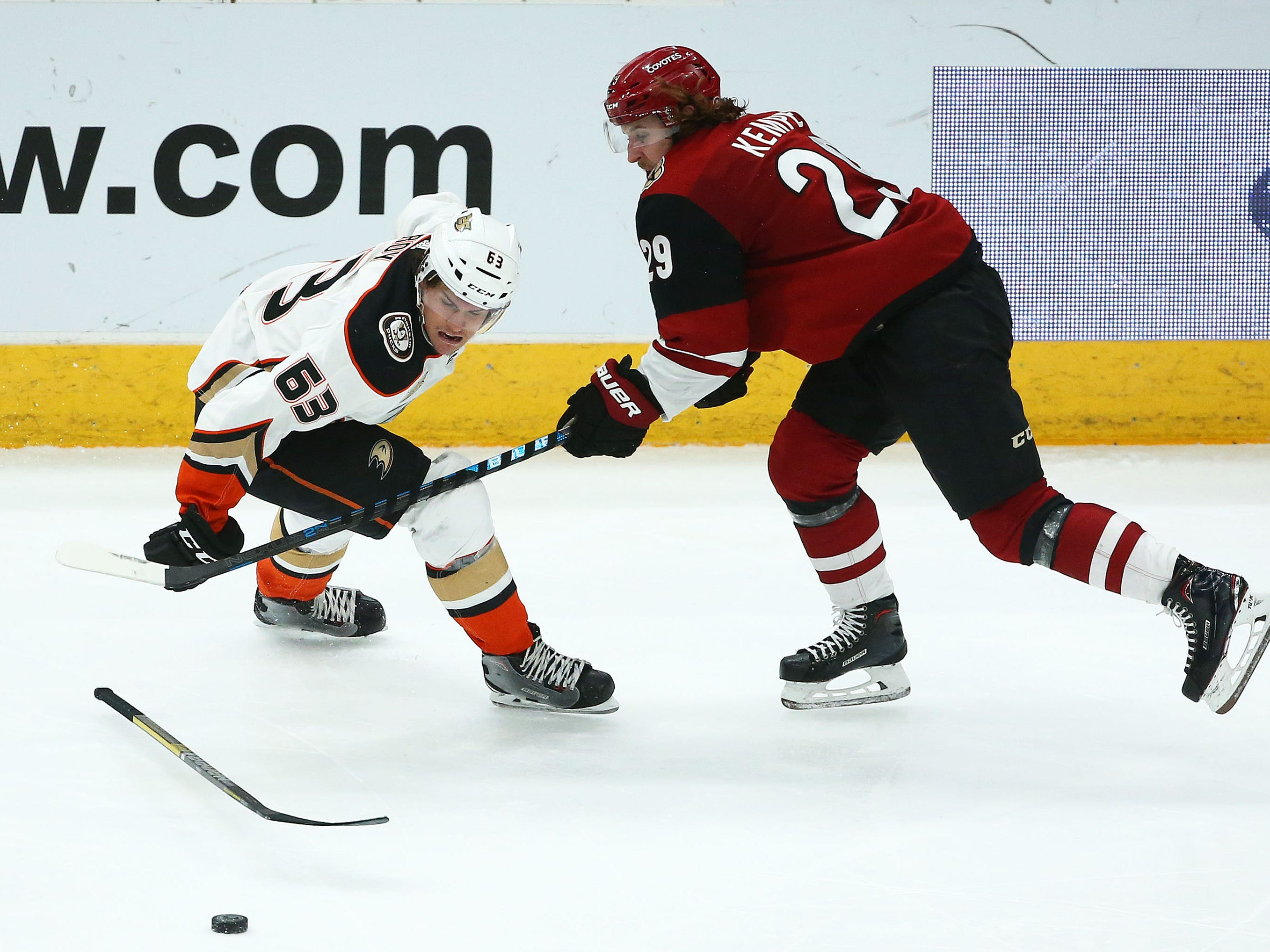 Arizona Coyotes right wing Mario Kempe (29) is called for slashing against Anaheim Ducks left wing Kevin Roy (63) in the third period on Mar. 5, 2019, at Gila River Arena in Glendale, Ariz.
