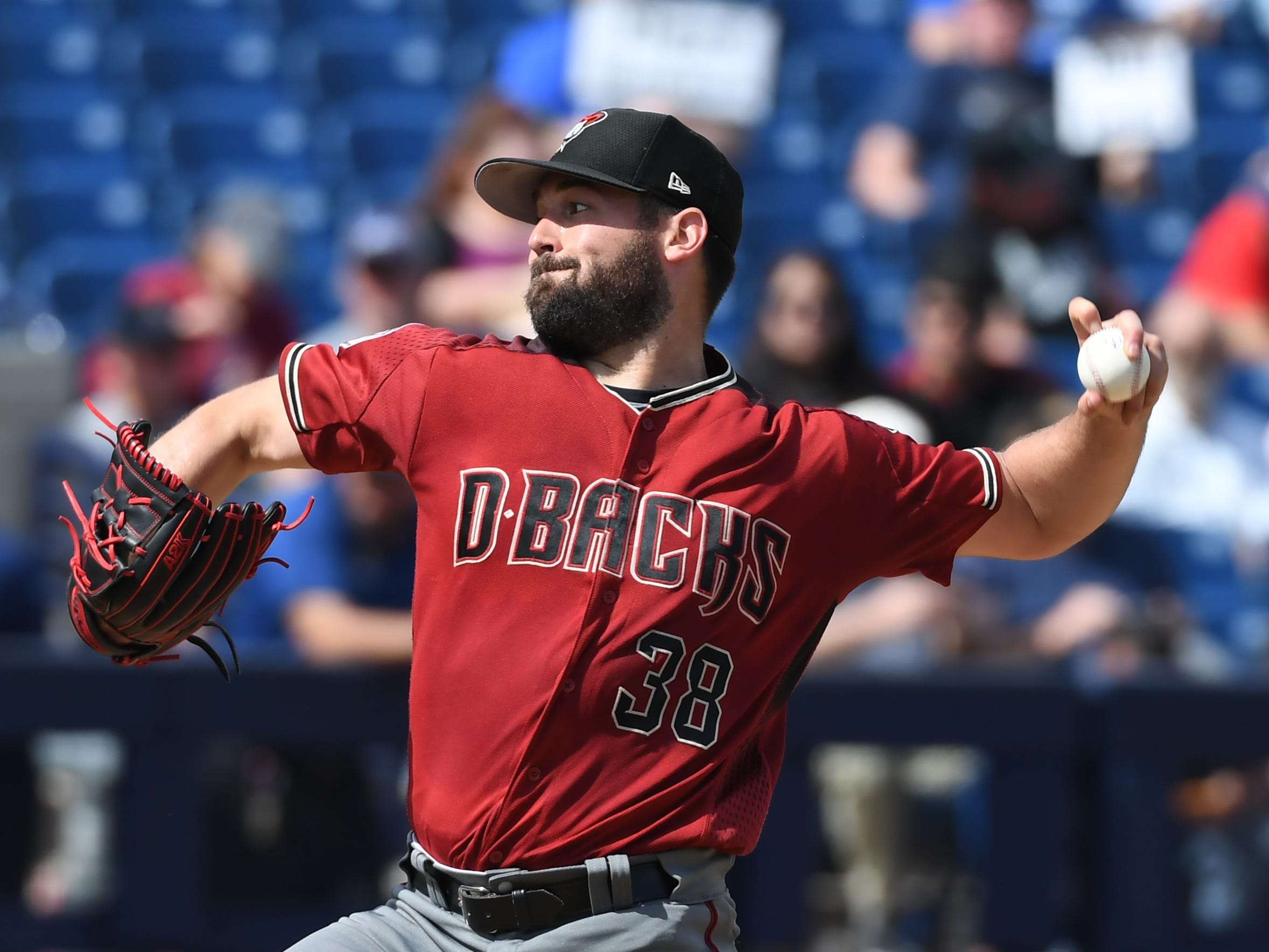 Robbie Ray #38 of the Arizona Diamondbacks delivers a third inning pitch against the Milwaukee Brewers during a spring training game at Maryvale Baseball Park on March 06, 2019 in Phoenix, Arizona.