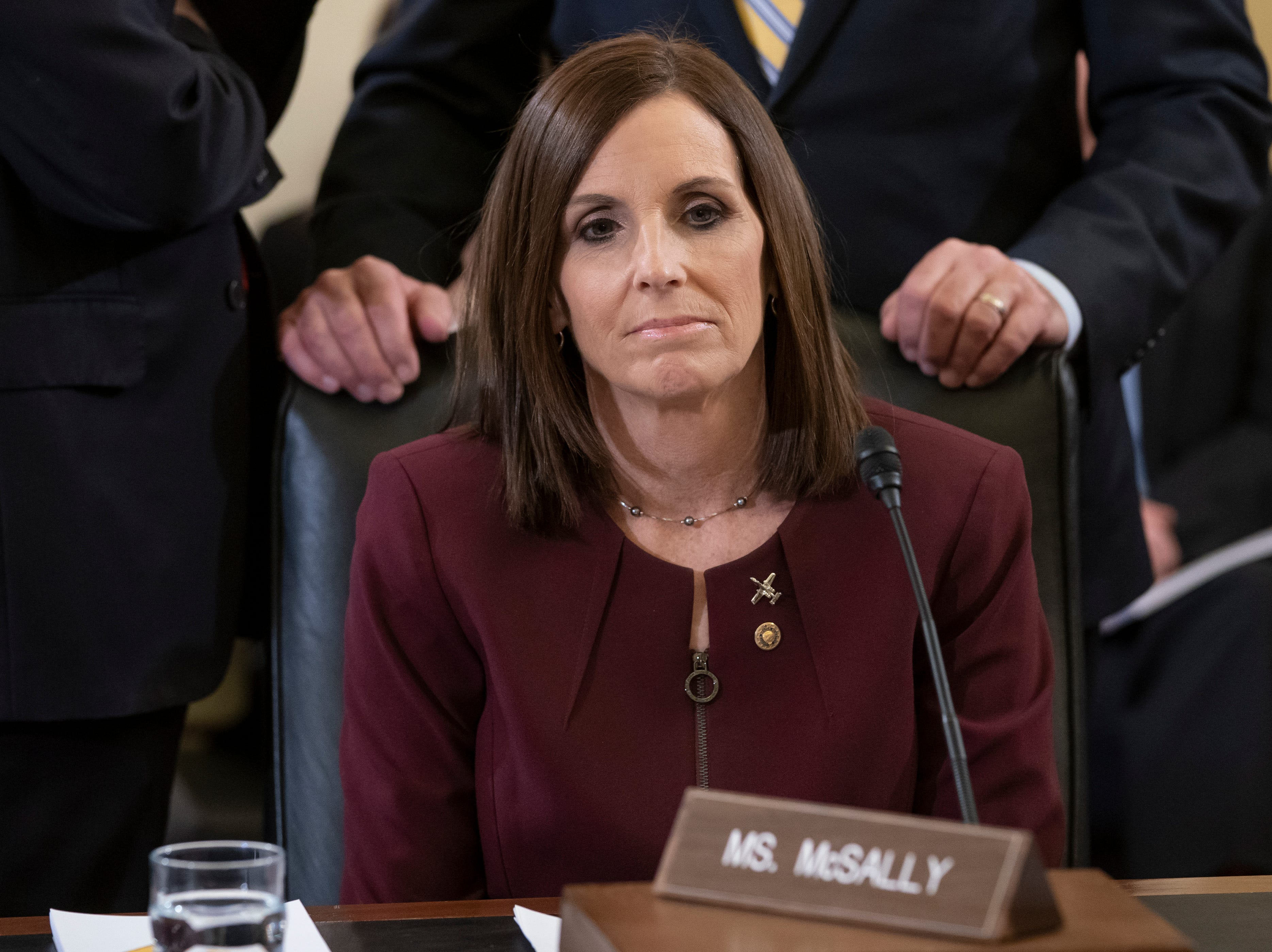Before a hearing by the Senate Armed Services Subcommittee on Personnel about prevention and response to sexual assault in the military, Sen. Martha McSally, R-Ariz., prepares to recount her own experience while serving as a colonel in the Air Force, on Capitol Hill in Washington, Wednesday, March 6, 2019. McSally, the first female fighter pilot to fly in combat, says she was raped in the Air Force by superior officer. (AP Photo/J. Scott Applewhite)