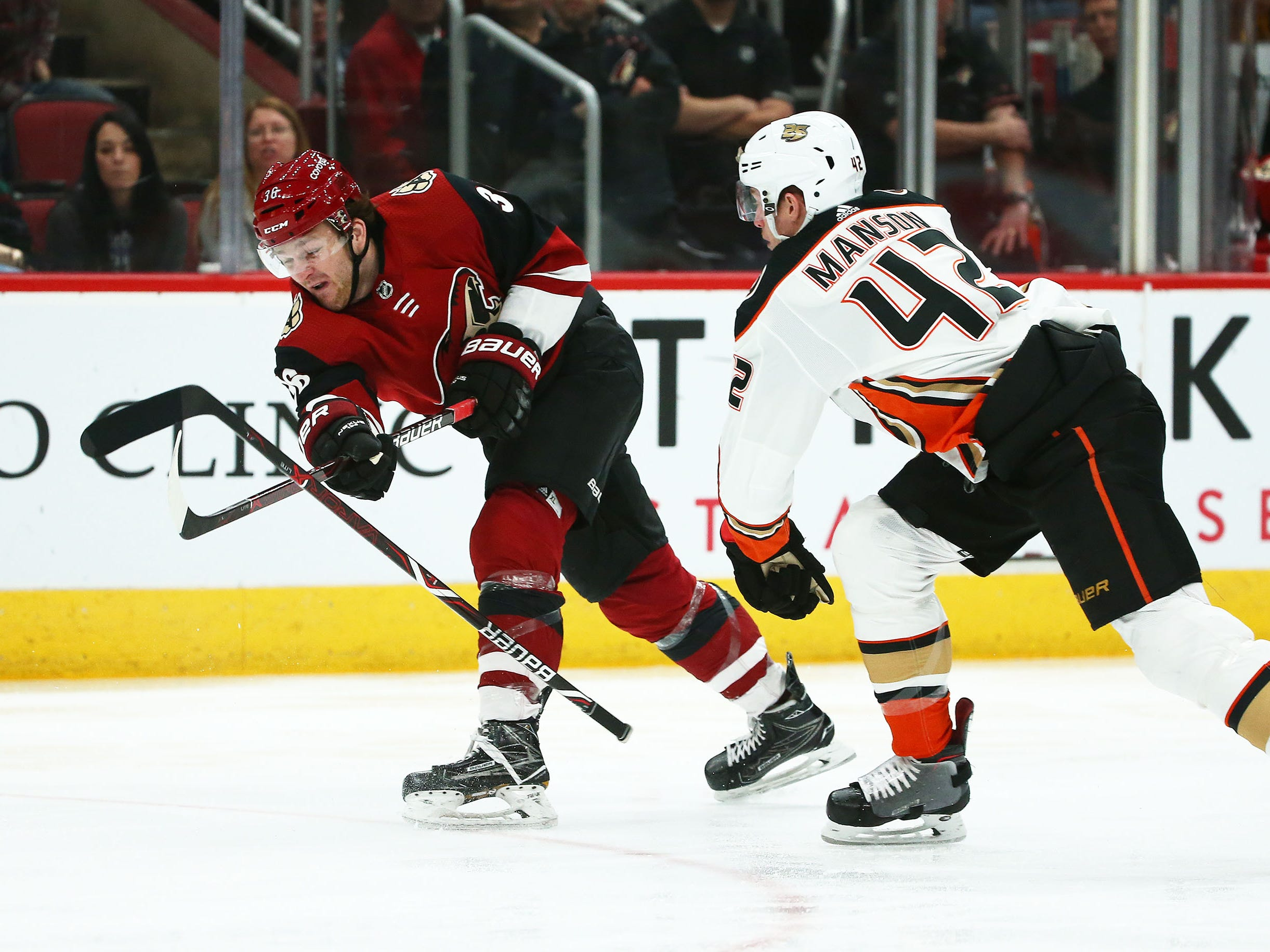 Anaheim Ducks defenseman Josh Manson (42) loses his stick against Arizona Coyotes right wing Christian Fischer (36) in the second period on Mar. 5, 2019, at Gila River Arena in Glendale, Ariz.