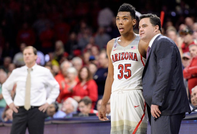 Arizona coach Sean Miller and guard Allonzo Trier look on from the sideline during a game on Jan. 13, 2018. Trier went undrafted after three seasons with the Wildcats.