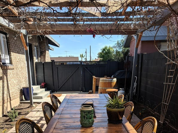 The couple's favorite spot is actually just outside the house, under a canopy of now-dormant grape vines, some sources from Dos Cabezas in southern Arizona.