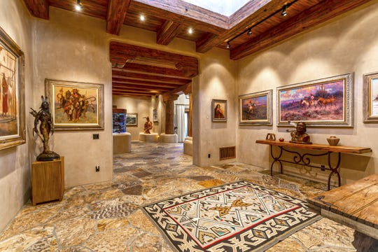 The foyer of the home, sold by James and Pat Warren, features a museum-style art gallery and an 800 gallon saltwater aquarium.