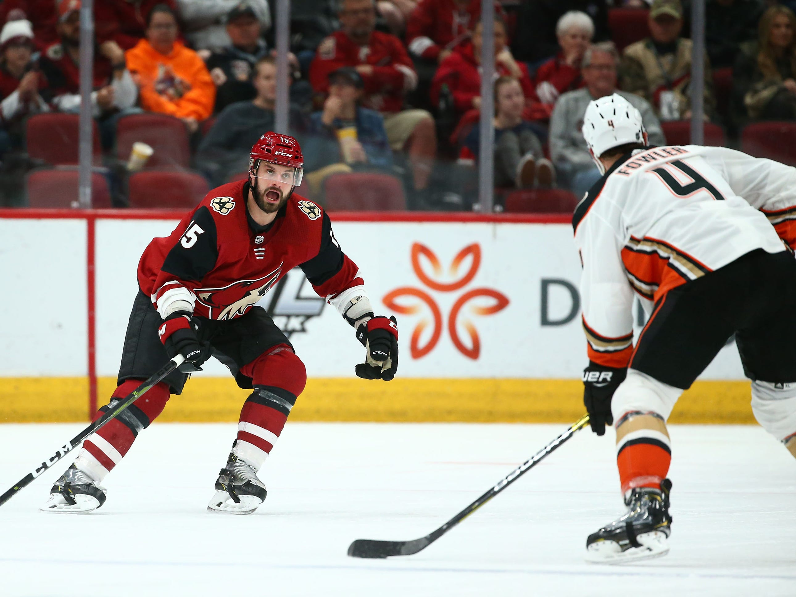 Arizona Coyotes center Brad Richardson (15) guards Anaheim Ducks defenseman Cam Fowler (4) in the second period on Mar. 5, 2019, at Gila River Arena in Glendale, Ariz.