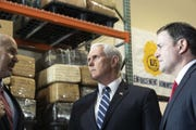 Vice President Mike Pence and Gov. Doug Ducey listen to a DEA agent during a tour of a U.S. Drug Enforcement Administration facility in the Phoenix area on March 5, 2019.