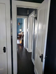 The couple lucked out and didn't have to renovate much after moving in, but they did cover the home's original floors with dark wood to avoid getting any more splinters.