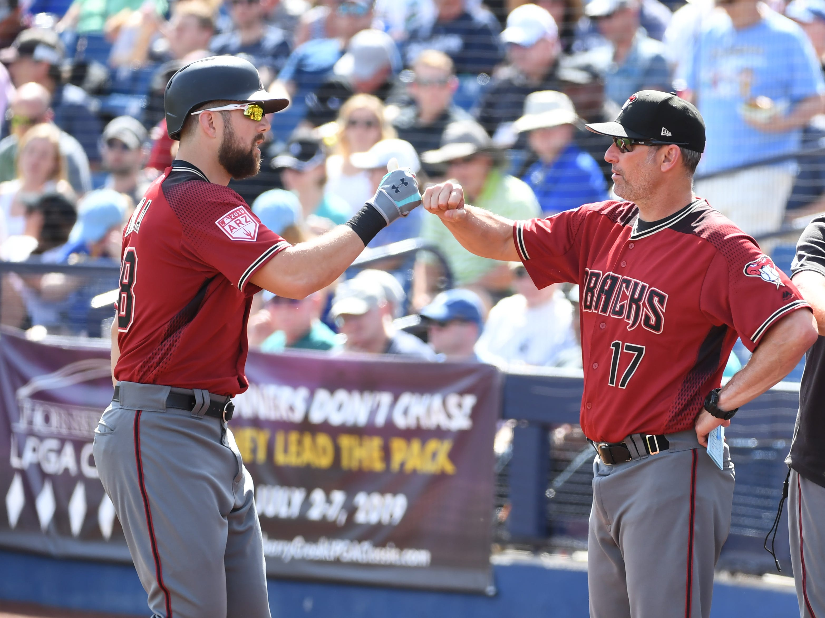 Steven Souza Jr #28 of the Arizona Diamondbacks is congratulated by manager Torey Lovullo #17 after hitting a home run against the Milwaukee Brewers during the second inning of a spring training game at Maryvale Baseball Park on March 06, 2019 in Phoenix, Arizona.