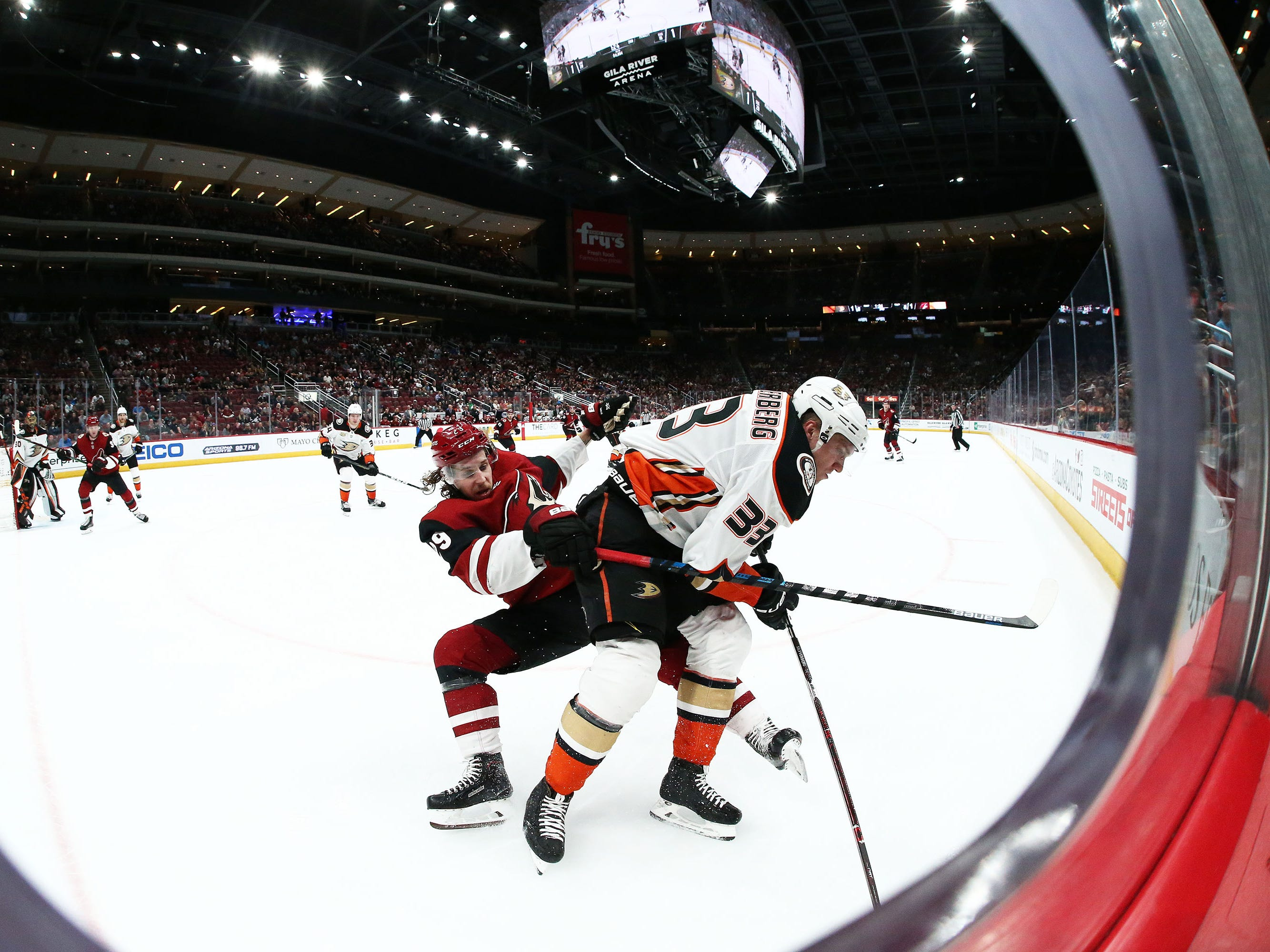 Arizona Coyotes right wing Mario Kempe (29) collides with Anaheim Ducks right wing Jakob Silfverberg (33) in the second period on Mar. 5, 2019, at Gila River Arena in Glendale, Ariz.