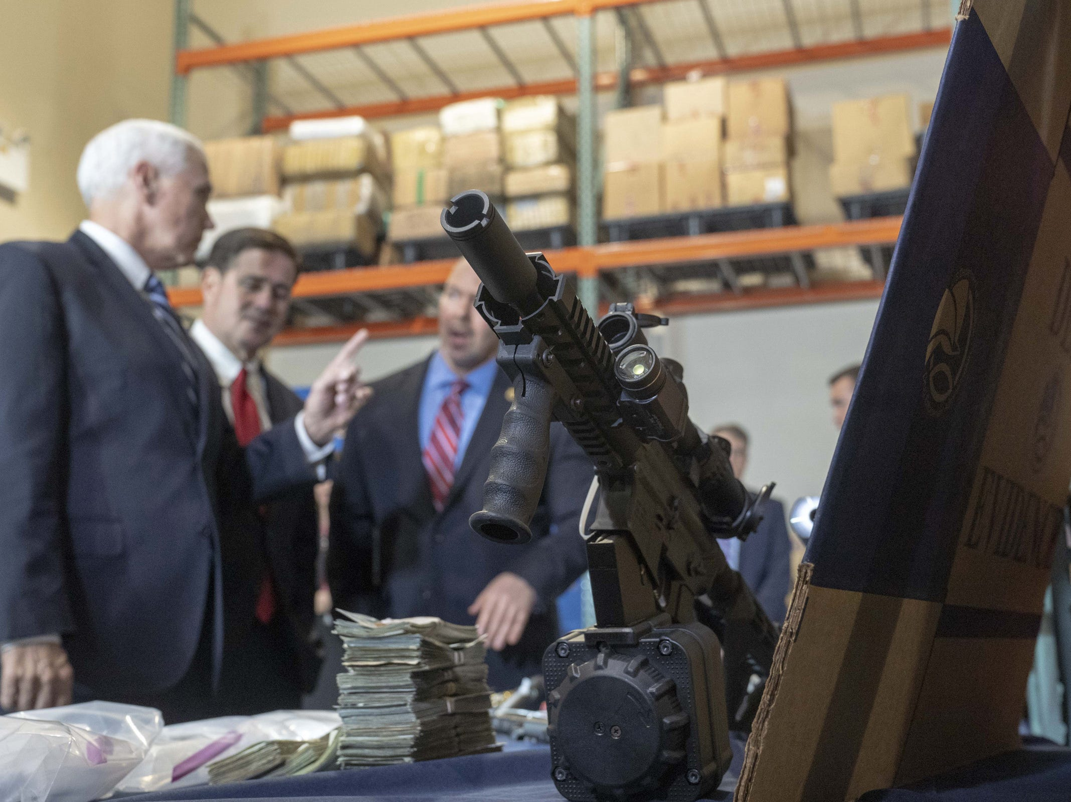 Vice President Mike Pence and Gov. Doug Ducey see stored drugs, weapons and cash during a tour of a U.S. Drug Enforcement Administration facility in the Phoenix area on March 5, 2019.