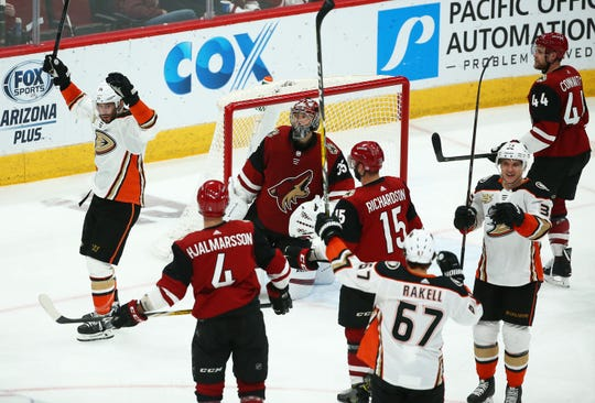 Anaheim Ducks center Adam Henrique (14) reacts after scoring a goal against Arizona Coyotes goaltender Darcy Kuemper (35) in the third period on Mar. 5, 2019, at Gila River Arena in Glendale, Ariz.