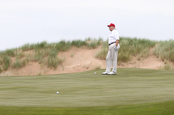 President Donald Trump golfs at one of his courses. The president hit the links several times between January and March 2020, as the coronavirus pandemic unfolded.