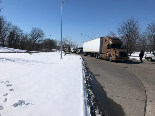 A Pennsylvania state trooper runs a checkpoint for tractor trailers at the Interstate 81 northbound mile 79.5 checkpoint near Grantville on March 5, 2019. Troopers confirm that drivers have active CDLs during the stop.
